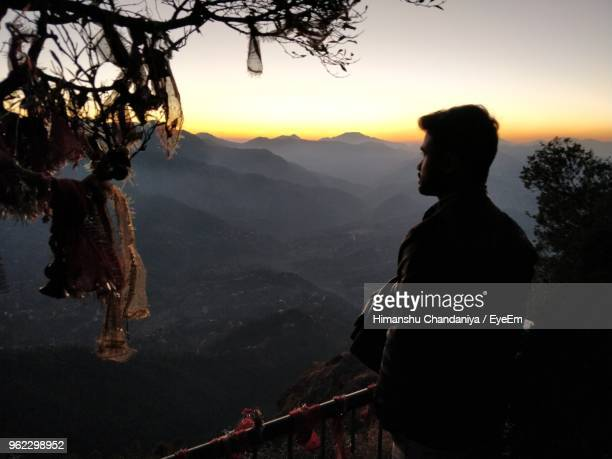 Man Looking At View During Sunset