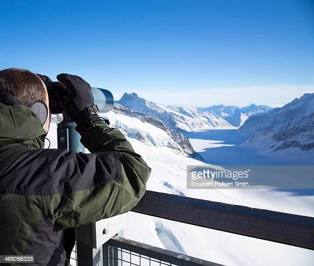 Man looking at view from Junfraujoch, Switzerland