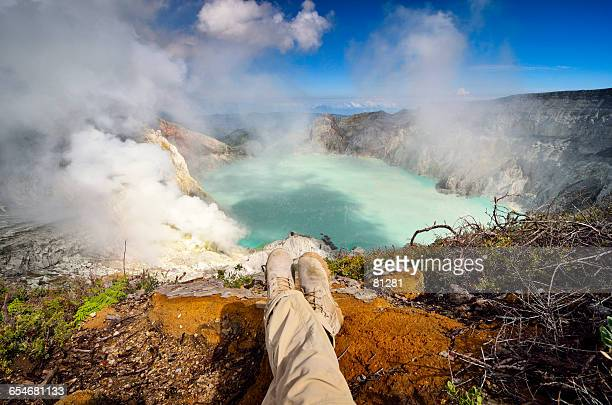 Man looking at view, Ljen volcano, East Java, Indonesia