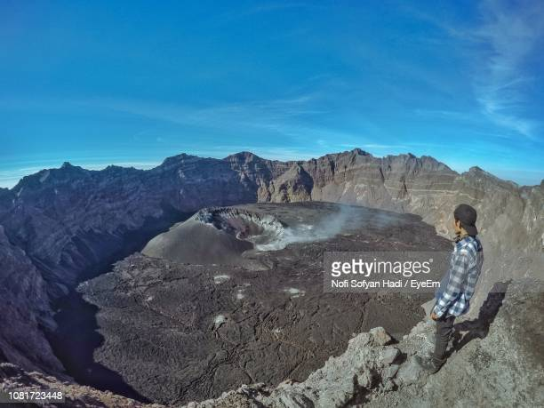 Man Looking At View On Volcanic Landscape
