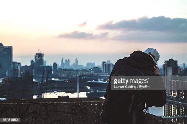 Man Looking At View Through Binoculars