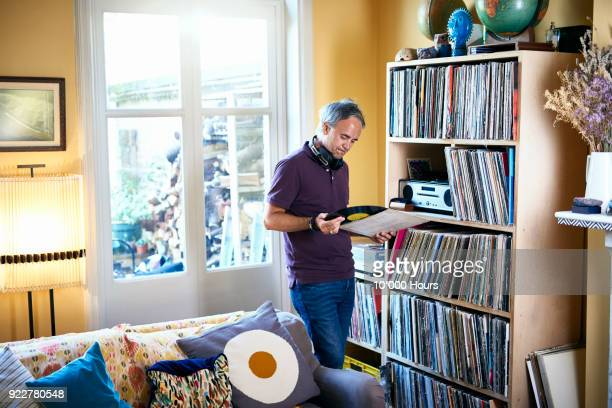 man looking at vinyl record - record analog audio stock pictures, royalty-free photos & images