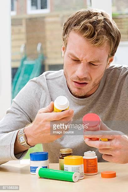 Man looking at vitamins and supplements