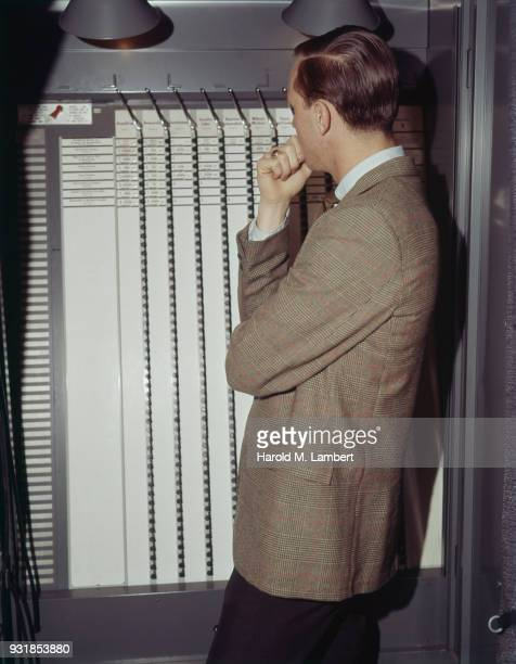 Man looking at voting machine