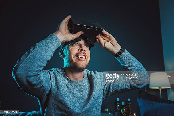 Man looking at VR film with virtual reality glasses headset