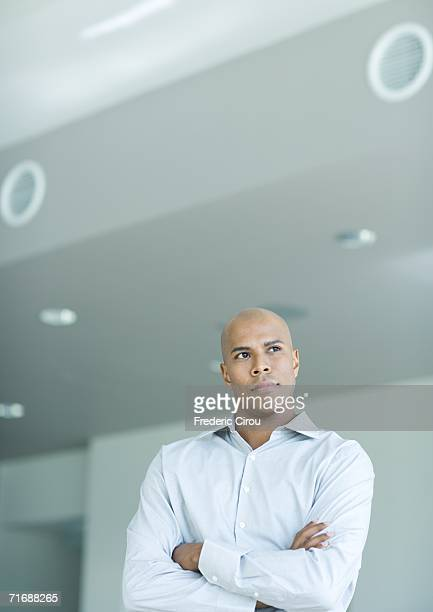 Man looking away, arms folded, portrait