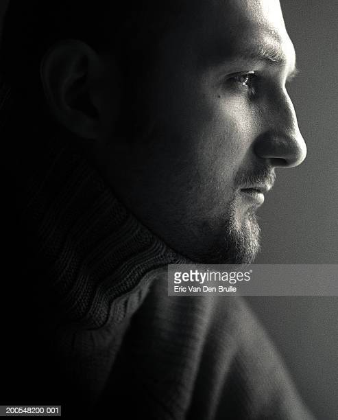 man looking away, close-up, side view - eric van den brulle stock-fotos und bilder