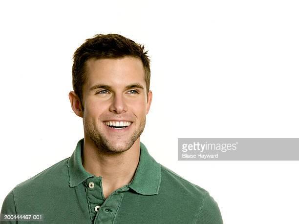 Man looking away, smiling