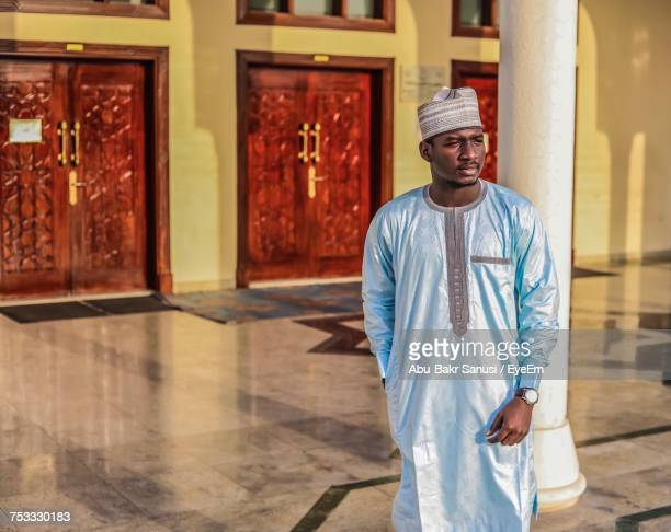 man looking away while wearing traditional clothing at mosque - nigeria stock pictures, royalty-free photos & images