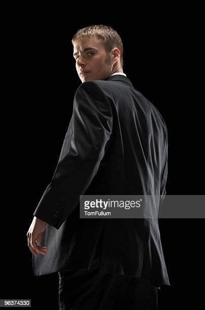 Man Looking Back Over Shoulder