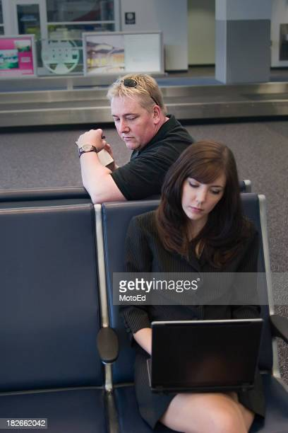 man looking behind shoulder at woman's laptop screen - thief stock pictures, royalty-free photos & images