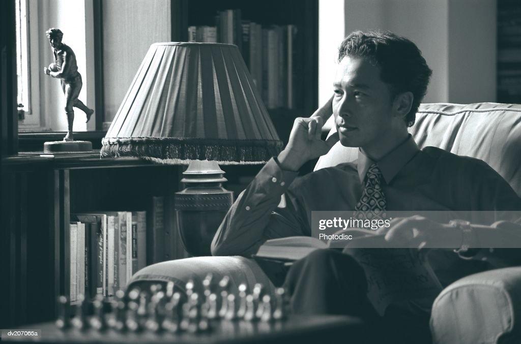 Man looking contemplative : Stock Photo