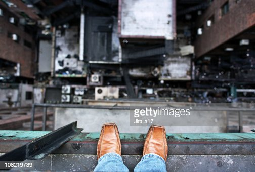 Man Looking Down From A High Ledge Suicide Concept Stock