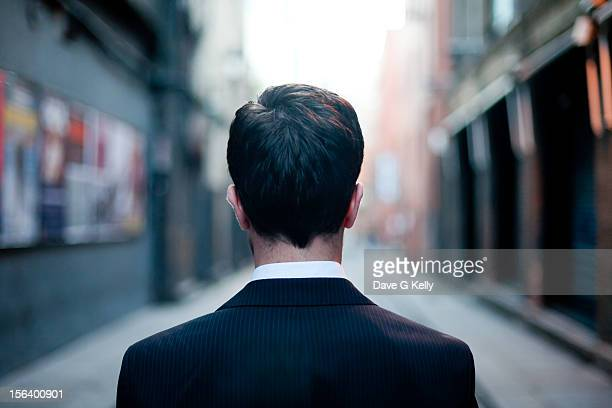 Man Looking Down the Alley