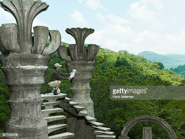 man looking for directions on a surreal structure - las posas stock pictures, royalty-free photos & images