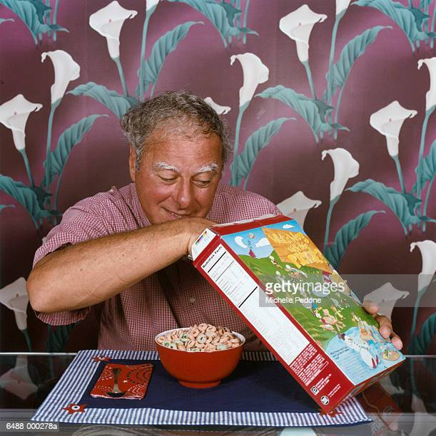 Man Looking in Cereal Box