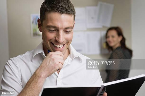 Man looking in notebook