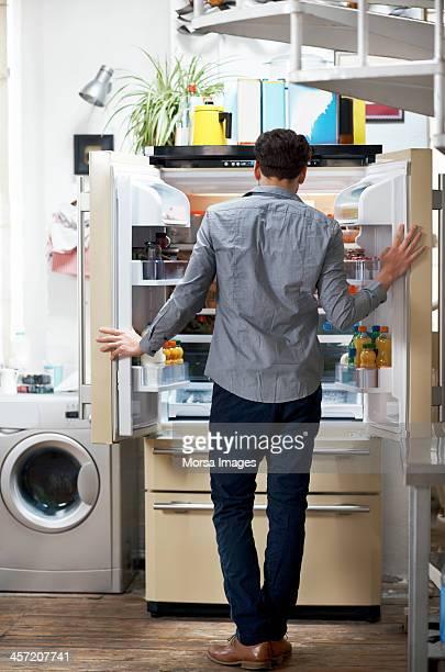 Man looking in the fridge