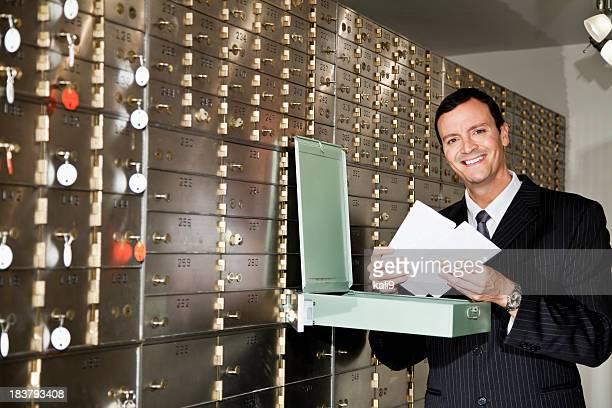 Man looking inside safety deposit box