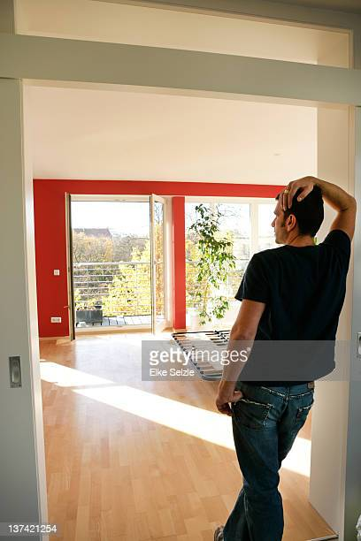 Man looking into empty apartment