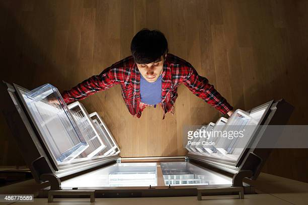 man looking into empty fridge at night - empty fridge stock pictures, royalty-free photos & images