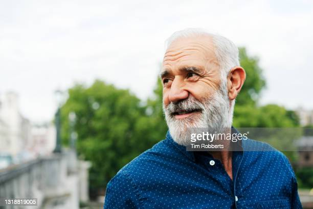 man looking off camera - adult stock pictures, royalty-free photos & images