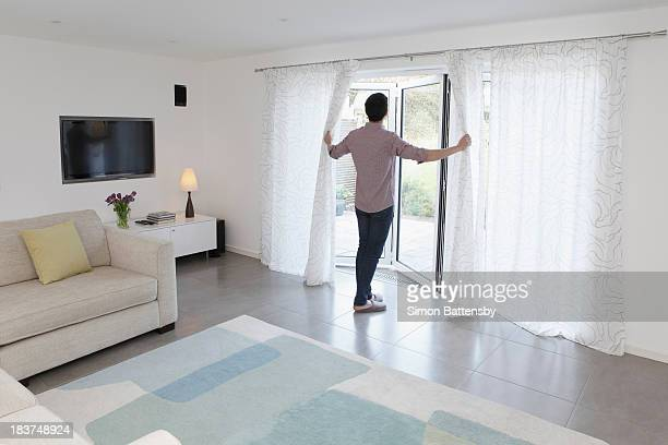 Man looking out of glass door
