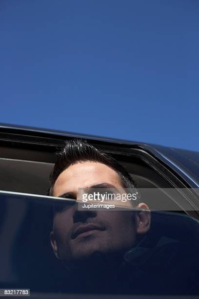 Man looking out of tinted window