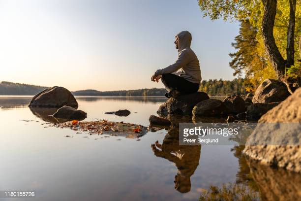 man looking out over a lake - north stock pictures, royalty-free photos & images