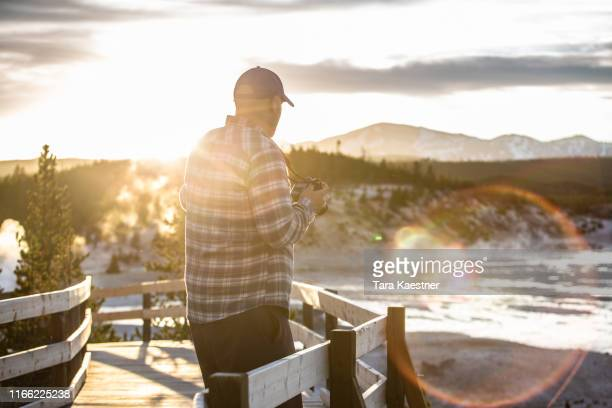 man looking out over the yellowstone landscape at sunset - passagerarbåt bildbanksfoton och bilder