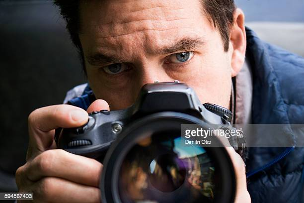 Man looking over camera lens
