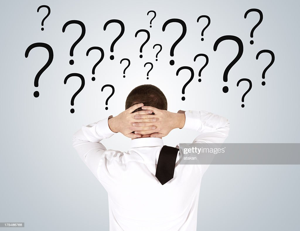 Man looking question mark : Stock Photo