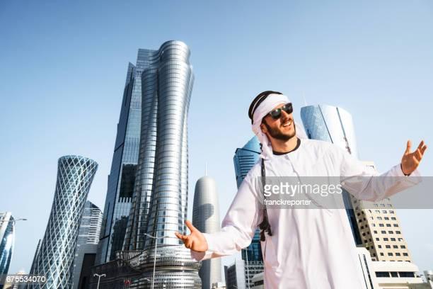 man looking the doha skyline in qatar