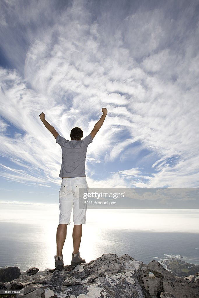 Man looking the view with arms up : Stock Photo