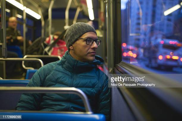 man looking through bus window - public transport stock pictures, royalty-free photos & images
