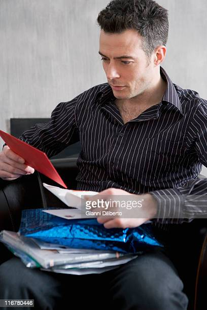 a man looking through his mail - thinking of you card stock pictures, royalty-free photos & images