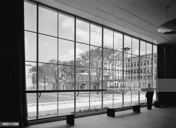 Man Looking Through Large Window in Acoustics Foyer Bell Telephone Laboratories Murray Hill New Jersey USA GottschoSchleisner Collection May 1942