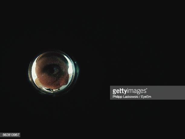 man looking through peep hole - peeping holes ストックフォトと画像