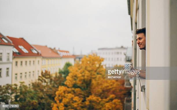 Man looking through the apartment window in Berlin Prenzlauer Berg