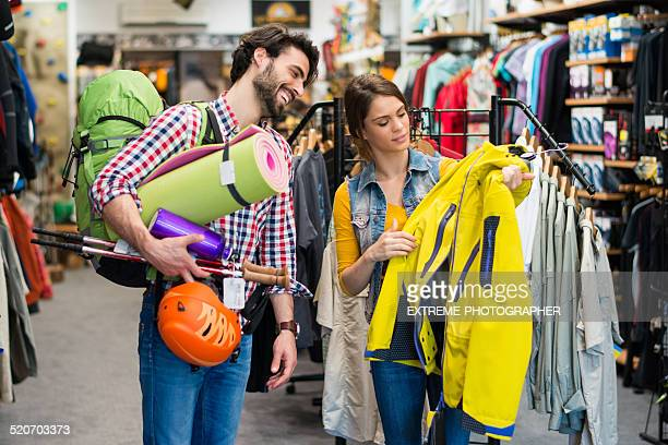 man looking to buy jacket and outdoor equipment - sports equipment stock pictures, royalty-free photos & images