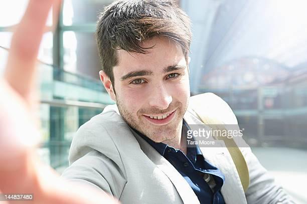 man looking to camera taking self portrait - selbstportrait stock-fotos und bilder