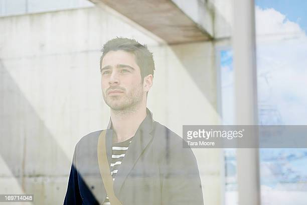man looking to sky through glass