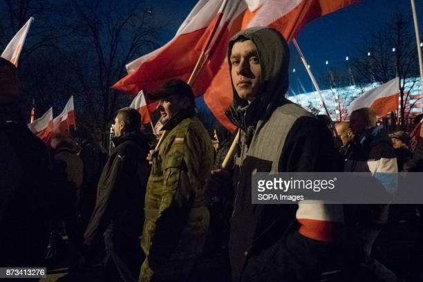 Man looking to the camera during the annual nationalist march of Poland´s Independency Day Poland's Independence Day is a annual day to mark the...