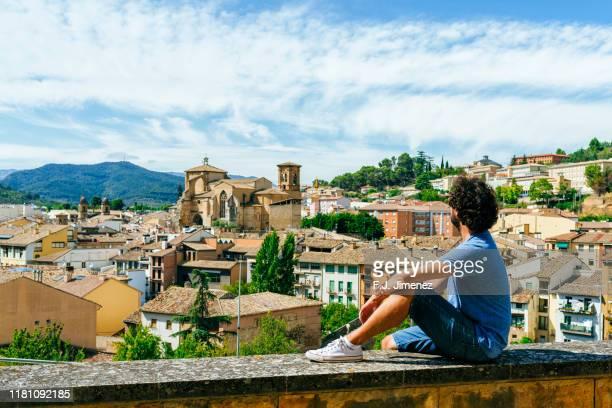 man looking towards the estella village in navarra, spain - comunidad foral de navarra fotografías e imágenes de stock