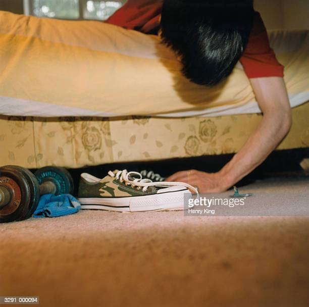 Man Looking Under Bed