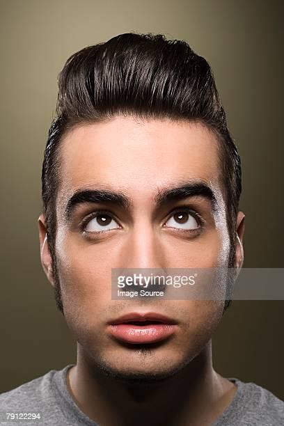Man looking up at his hair