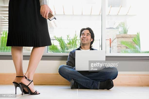Man Looking up at Woman