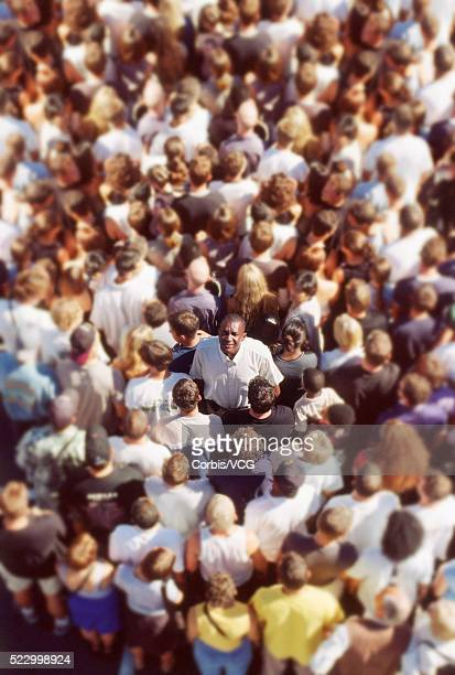 Man Looking Up from Crowd