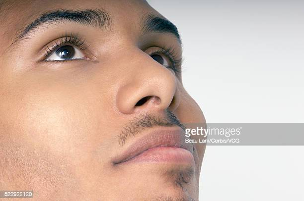 man looking up - wishful skin stock pictures, royalty-free photos & images