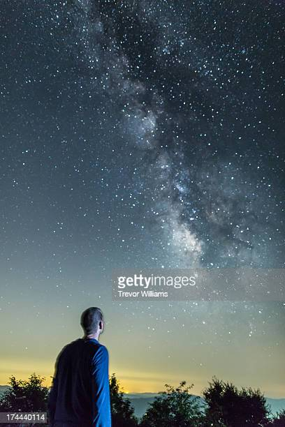 A man looking up the Milky Way